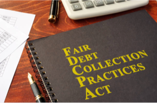 notebook with the words Fair Debt Collection Practices Act